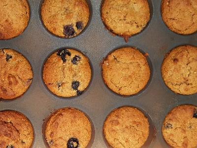 Blueberry and Almond muffins in muffin trays